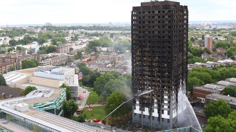 Theresa May 'welled up' in meeting with Grenfell families, says reverend